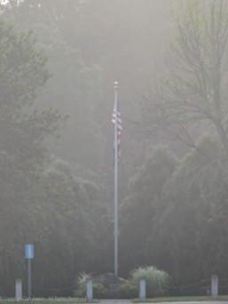 Shrouded in fog, the flag is still flying.