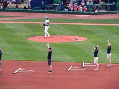 The grounds crew stops and performs YMCA