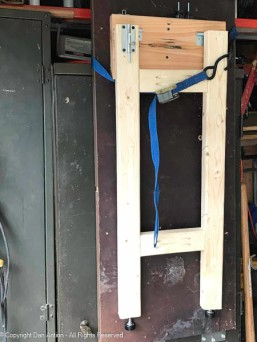 The cabinet is made with heavy gauge steel. The strap is temporary, I'll figure out a more permanent lock in the future.