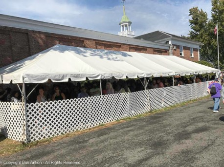 All of those people are waiting in line to get a Maine baked potato.