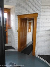 This door leads to a short corridor which leads to the circular staircase.