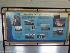 Inside the fog horn building is a display of informational posters. This one talks about the derrick, tram and the boats that serviced the station