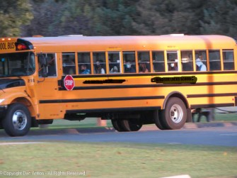 They're wearing masks, but it's good to see a full school bus.