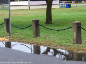 I like the chains reflected in the puddles
